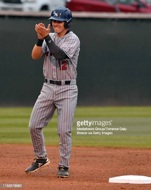 LMU's Trevin Esquerra celebrates at second base after a hit by Tommy Delgado at Jackie Robinson Stadium in Los Angeles on Monday June 3 2019