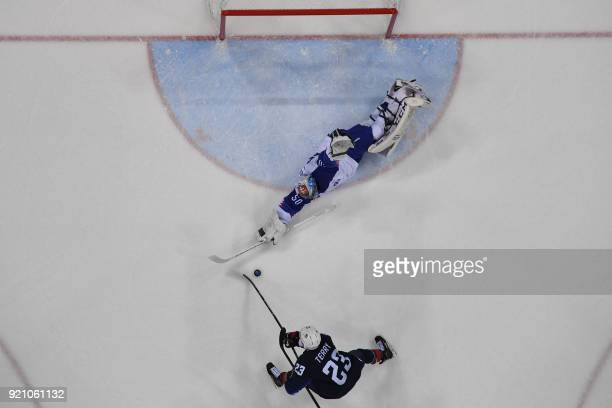 TOPSHOT USA's Troy Terry tries to score a goal past Slovakia's Jan Laco in the men's playoff qualifications ice hockey match between the United...
