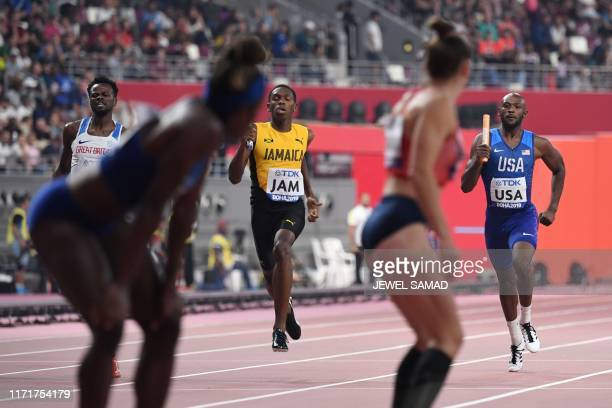 USA's Tyrell Richard runs to pass the baton to USA's Jessica Beard in the Mixed 4 x 400m Relay heats at the 2019 IAAF World Athletics Championships...