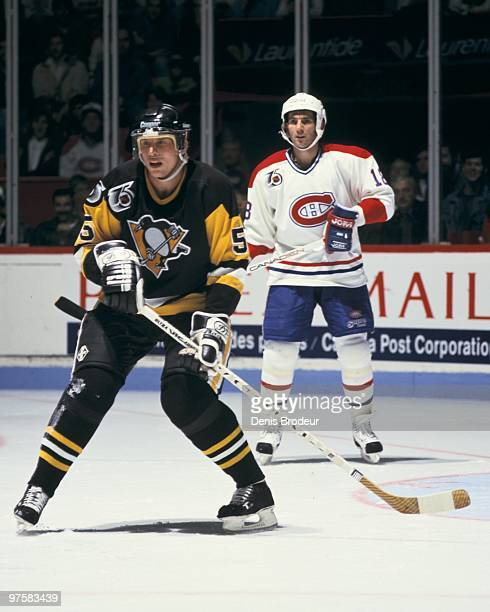 MONTREAL 1990's Ulf Samuelsson of the Pittsburgh Penguins skates against Denis Savard of the Montreal Canadiens in the early 1990's at the Montreal...