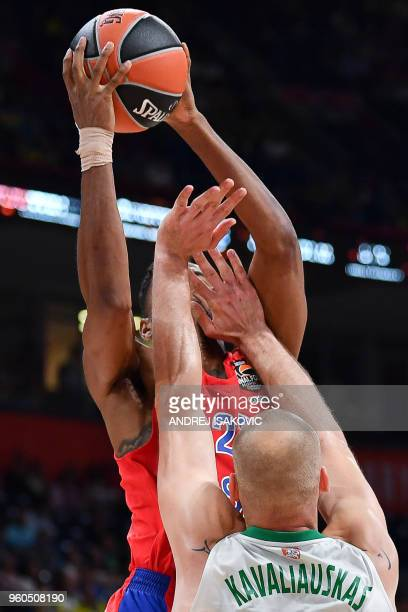 CSKA's US guard Cory Higgins jumps to shoot against Zalgiris' Lithuanian center Antanas Kacvaliauskas during the Euroleague Final Four thirdplace...