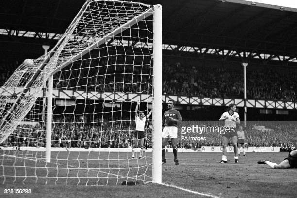 USSR's Valeri Porkuyan watches the ball hit the net after tapping in his team's only goal of the match as West Germany's Willi Schulz appeals for...