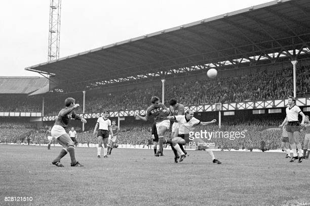 USSR's Valeri Voronin beats teammate Valeri Porkuyan and West Germany's Willi Schulz to a header watched by teammate Eduard Malofeev and West...