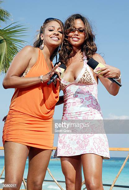 VJ's Vanessa Minnillo on right and La La pose for a photo on stage during taping for MTV Spring Break 2004 on the beach deck at The City March 12...