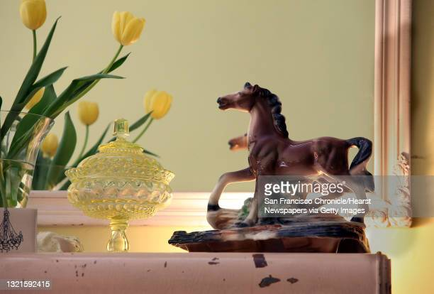 S vaseline glass candy dish and 1950's horse tv lamp in front of a vintage bow mirror at Home 101 in Berkeley, Calif., on Monday, January 24, 2011.