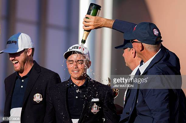 USA's ViceCaptain Tom Lehman pours champagne on Rickie Fowler's head and Jimmy Walker laughs as they celebrate winning the 41st Ryder Cup at...