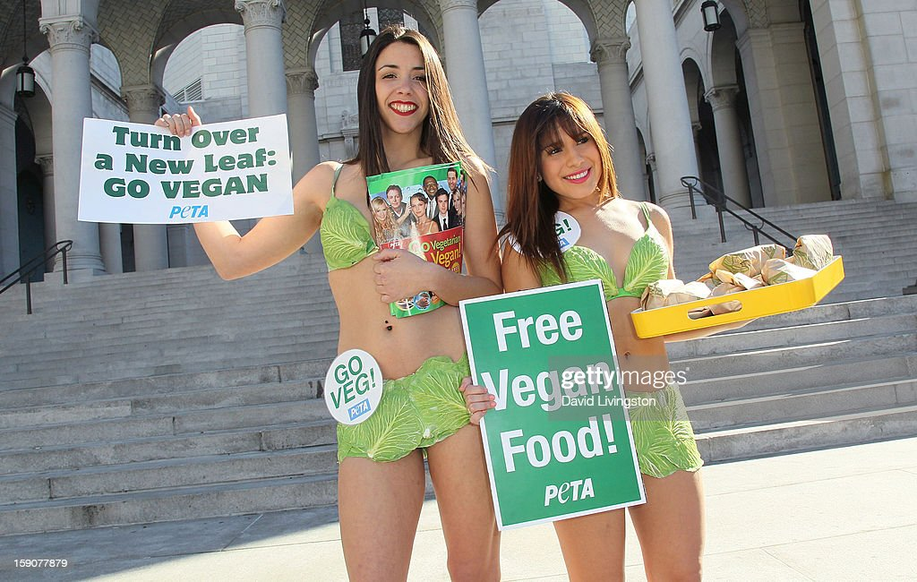 PETA's Virginia Fort (L) and Ashley Perez attend PETA's Sexy Lettuce Ladies unveiling of the new PETA 'Turn Over A New Leaf: Go Vegan' campaign at Los Angeles City Hall on January 7, 2013 in Los Angeles, California.