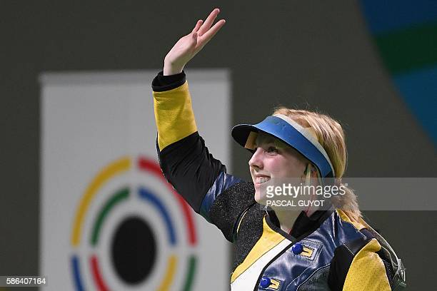 USA's Virginia Thrasher celebrates after winning the women's 10m air rifle shooting final at the Rio 2016 Olympic Games at the Olympic Shooting...