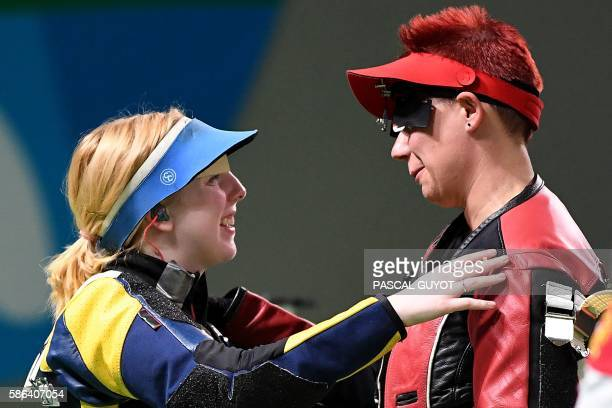USA's Virginia Thrasher is congratulated by Croatia's Snjezana Pejcic after winning the women's 10m air rifle shooting final at the Rio 2016 Olympic...
