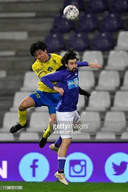 STVV's Wataru Endo and Beerschot's Diego Montiel fight for the ball during a soccer match between KFCO Beerschot Wilrijk and SintTruidense VV...