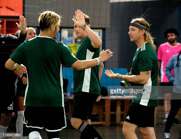 DJ's Wax Motif and Diplo celebrate during the Copa Del Rave Charity Soccer Tournament at Evolve Project LA on April 17 2019 in Los Angeles California