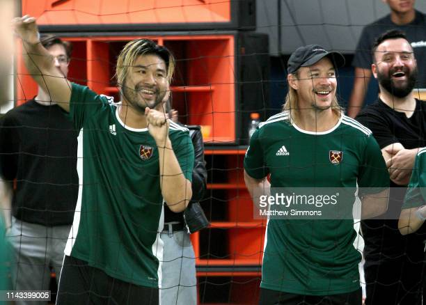 DJ's Wax Motif and Diplo watch as their team competes during the Copa Del Rave Charity Soccer Tournament at Evolve Project LA on April 17 2019 in Los...