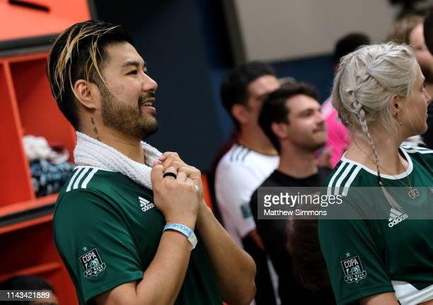 DJ's Wax Motif watches as his team competes during the Copa Del Rave Charity Soccer Tournament at Evolve Project LA on April 17 2019 in Los Angeles...