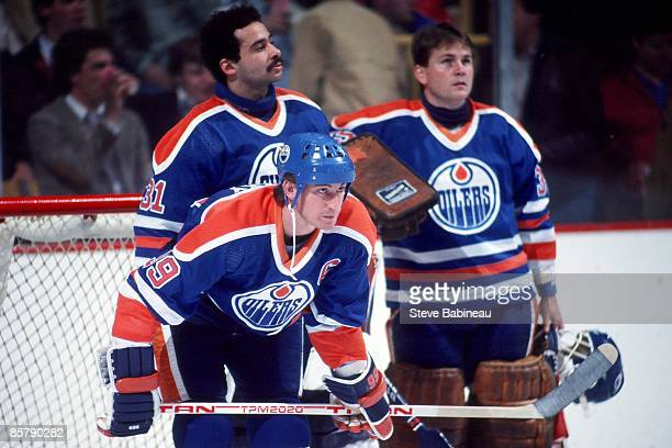 BOSTON MA 1980's Wayne Gretzky Grant Fuhr and Andy Mood of the Edmonton Oilers prior to the start of the game against the Boston Bruins at the Boston...