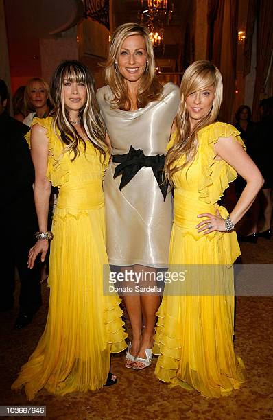 S WCRF co-founder Jamie Tisch poses with Juicy Couture's co-founders, co-presidents, co-designers Gela Nash-Taylor and Pamela Skaist-Levy at the Saks...
