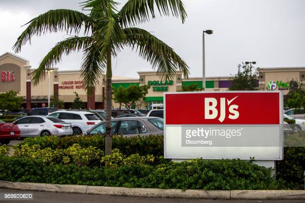 BJ's Wholesale Club Holdings Inc signage is displayed outside a shopping center in Miami Florida US on Thursday May 17 2018 The warehouseclub chain...