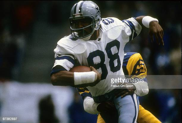 DALLAS TX CIRCA 1980's Wide Receiver Drew Pearson of the Dallas Cowboys in action trying to get out of the grasp of a Los Angeles Rams defender circa...