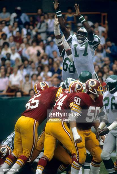 PHILADELPHIA PA CIRCA 1970's Wide Receiver Harold Carmichael of the Philadelphia Eagles in the air attemting to block a fieldgoal against the...