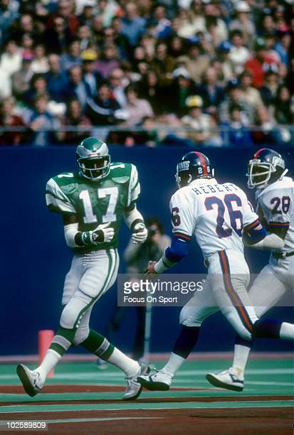 RUTHERFORD NJ CIRCA 1980's Wide Receiver Harold Carmichael of the Philadelphia Eagles misses a pass in front of defensive back Bud Herbert of the New...