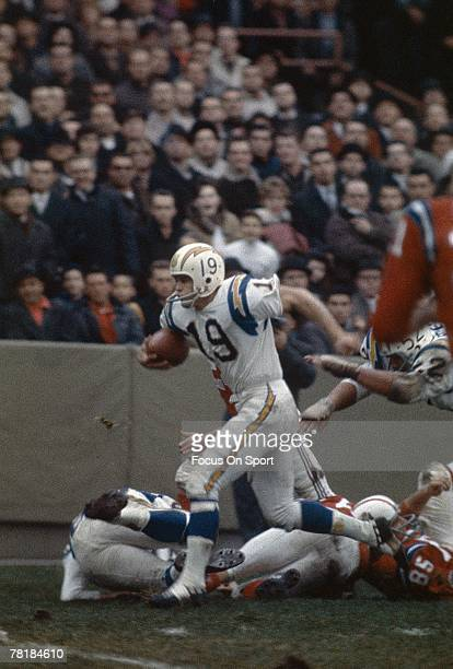 BOSTON MA CIRCA 1960's Wide Receiver Lance Alworth of the San Diego Chargers runs through the Boston Patriots defense during a circa 1960's NFL...