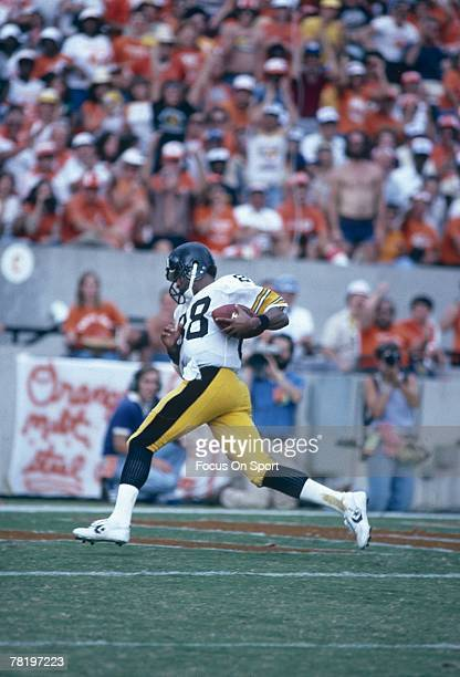 DENVER CO CIRCA 1970's Wide Receiver Len Swann of the Pittsburgh Steelers scores against the Denver Broncos during a mid circa 1970's NFL football...