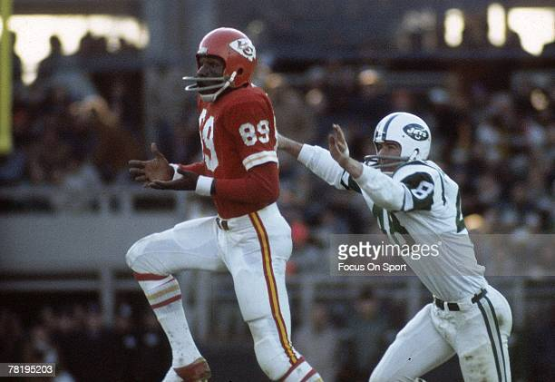 CITY MO CIRCA 1970's Wide Receiver Otis Taylor of the Kansas City Chiefs catches a pass over a New York Jets defender during a early circa 1970's NFL...