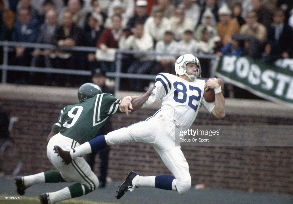 PHILADELPHIA, PA - CIRCA 1960's: Wide Receiver Raymond Berry #82 of the Baltimore Colts catches a pass over a Philadelphia Eagles defender during a circa 1960's NFL football game at Franklin Field in Philadelphia, Pennsylvania. Berry played for the Colts from 1955-67.