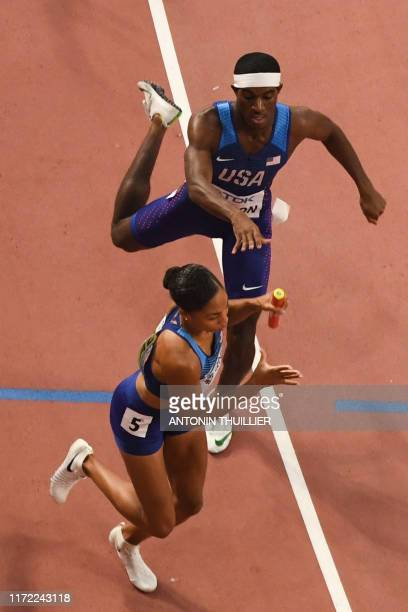 USA's Wilbert London passes the baton to USA's Allyson Felix in the Mixed 4 x 400m Relay final at the 2019 IAAF World Athletics Championships at the...