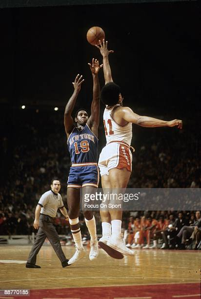 S: Willis Reed of the New York Knickerbockers in action shooting over Wes Unseld of the Baltimore Bullets during a late circa 1960's NBA basketball...