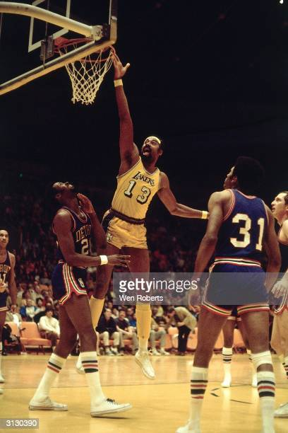 LOS ANGELES 1970's Wilt Chamberlain of the Los Angeles Lakers goes for a layup against the Detroit Pistons during an NBA game circa 1970's at the...