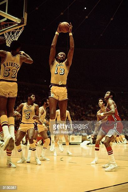 LOS ANGELES 1970's Wilt Chamberlain of the Los Angeles Lakers grabs a rebound against the Philadelphia 76ers during the NBA game circa 1970's at the...