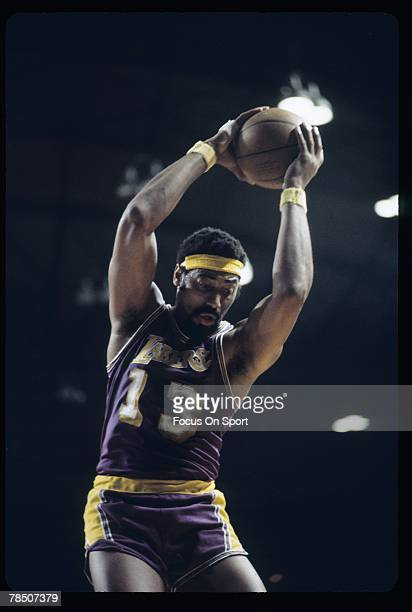 CIRCA 1970's Wilt Chamberlain of the Los Angeles Lakers grabs a rebound during an early circa 1970's NBA basketball game Chamberlain played for the...