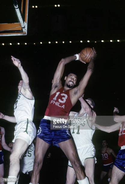 S: Wilt Chamberlain of the Philadelphia 76ers pulls down a rebound against the Boston Celtics during an mid circa 1960's NBA basketball game at the...