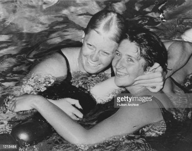 OF AUSTRALIA IS CONGRATULATED IN THE WATER BY G VON SALTZA OF THE UNITED STATES AFTER EQUALLING THE WORLD RECORD WHEN WINNING THE 100 METRES...