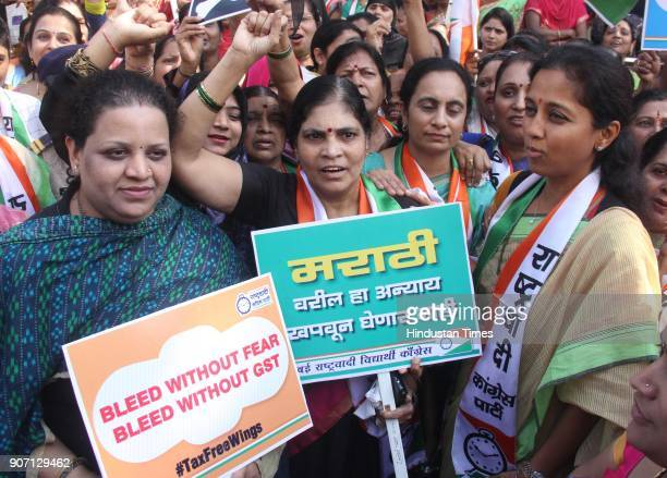 NCP's women wing president Supriya Sule with party workers protest outside the Sales Tax office demanding exclusion of sanitary napkins from the GST...