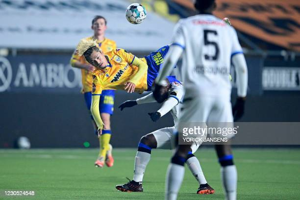 S Yuma Suzuki and Club's Eder Balanta fight for the ball during a soccer match between Sint-Truidense VV and Club Brugge, Sunday 10 January 2021 in...