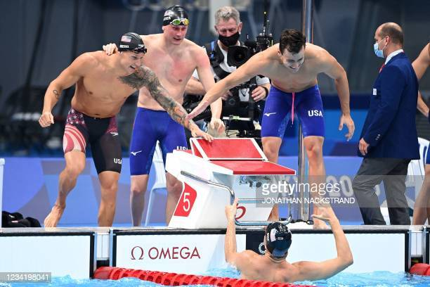 S Zach Apple celebrates with teammates Caeleb Dressel, USA's Blake Pieroni, and Bowen Becker as the celebrate winning to take gold in the final of...