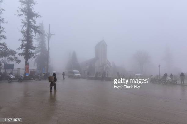 sa pa church in mist - sa pa stock photos and pictures