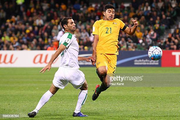 Saad Abdulameer of Iraq and Massimo Luongo of Australia contest for the ball during the 2018 FIFA World Cup Qualifier match between the Australian...
