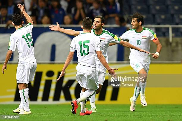 Saad Abdulameer of Iraq celebrates with his team mates after making their first goal during the 2018 FIFA World Cup Qualifiers match between Japan...