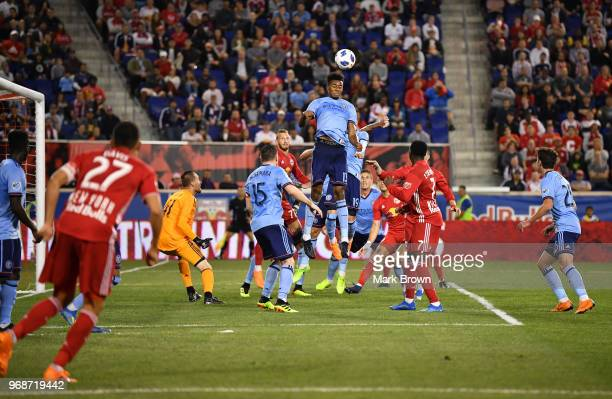 Saad AbdulSalaam of New York City FC head butts the ball in defense against the New York Red Bulls in the second half during the fourth round match...