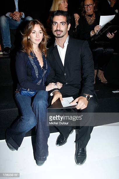 Saad Hariri and his wife attend the Elie Saab Ready to Wear Spring / Summer 2012 show during Paris Fashion Week at Espace Ephemere Tuileries on...