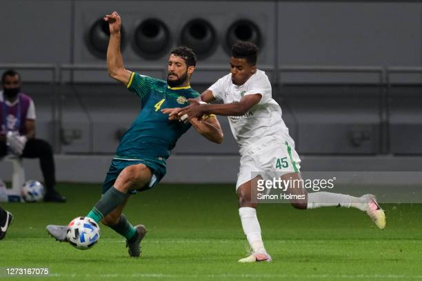 Saad Natiq and Haitham Asiri contest for the ball during the AFC Champions League match between Al Shorta and Al Ahli Saudi FC at Khalifa...