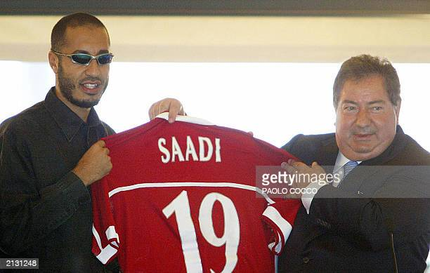 Saadi Kadhafi son of Libyan leader Moamar Kadhafi holds up his new Perugia soccer team jersey with the Italian team's president Luciano Gaucci during...