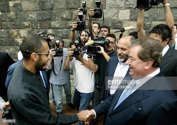 Saadi Kadhafi son of Libyan leader Moamar Kadhafi shakes hands with Perugia soccer team president Luciano Gaucci just before Kadhafi's official...