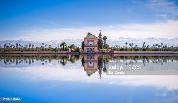 saadian pavilion, menara gardens and atlas in marrakech, morocco, africa - adobe stock pictures, royalty-free photos & images