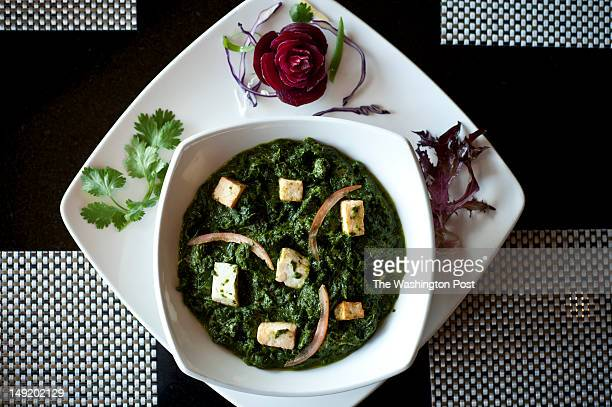 Saag Pineer -- homemade cottage cheese atop spinach puree with onions, herbs and spices -- at the Turmeric restaurant in Vienna, VA, Tuesday, July...