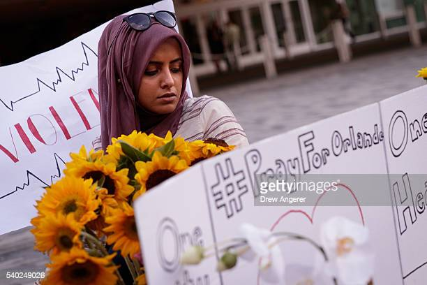 Saamiya Pirbhai from Husseini Islamic Center in Sanford Florida pauses while visiting at a makeshift memorial at the Dr Phillips Center for...