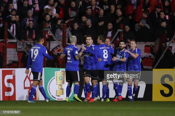 Saarbruecken players celebrate the goal of Tobias Janicke during the DFB Cup quarterfinal match between 1. FC Saarbruecken and Fortuna Duesseldorf at...