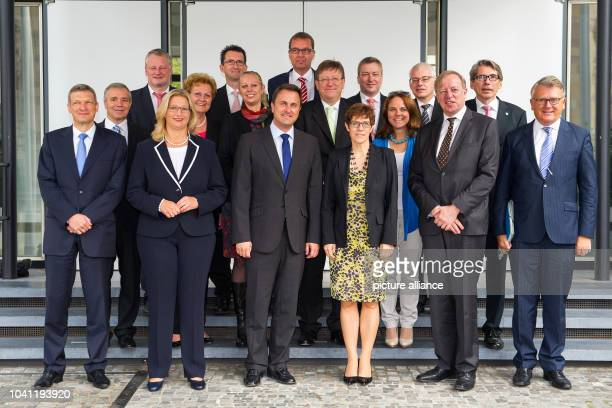 Saarland's and Luxembourg's ministers pose for a photo after a joint cabinet meeting of the governments of Saarland and Luxembourg in Saarbruecken...